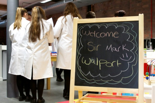 Chalk board saying 'Welcome Sir Mark Walport'