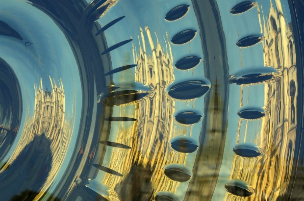 Cambridge reflected in the golden face of the 'Chronophage' clock. (credit: Tanya Hart/CC BY-SA 2.0)