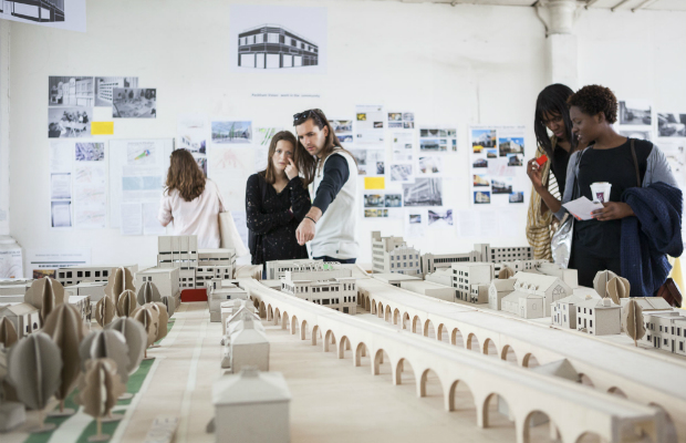 People looking at a model of the Peckham Coal Line.